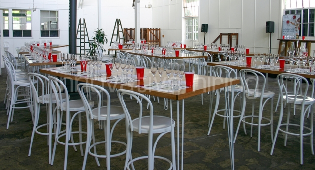 Cocktail Tables with Wine Glasses and Red Cups